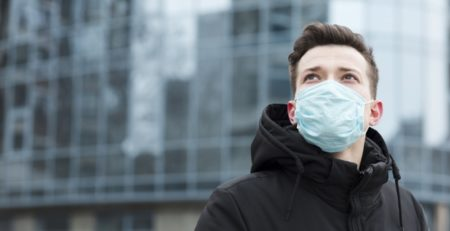 Man with medical mask in city